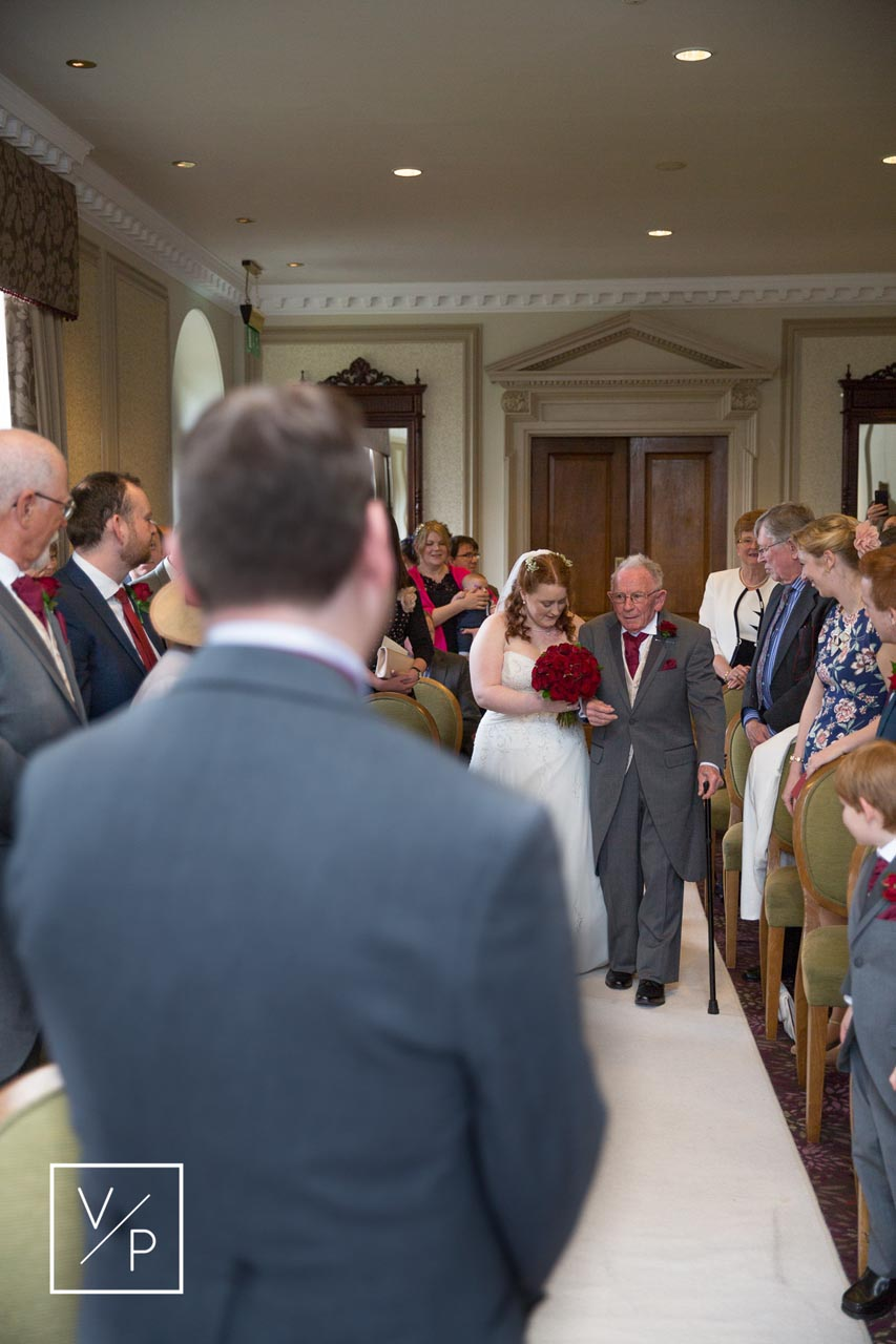 Horwood House wedding at Easter - Anna walking down the aisle by Veiled Productions.