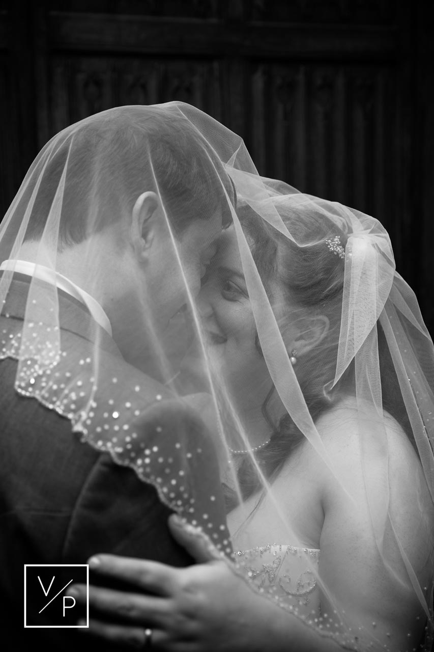 Horwood House wedding at Easter. Anna and Tim's wedding by Veiled Productions - hiding under the veil.