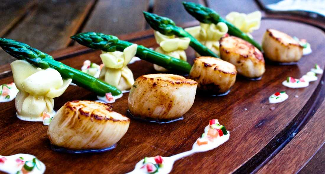 Scallops with their own tortellini and asparagus butter legumes sauce by Sanlo Events Wedding Catering
