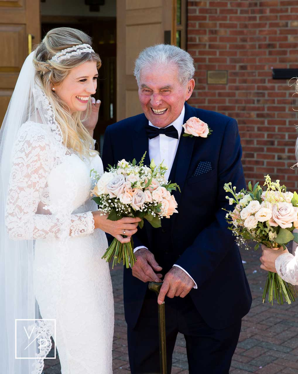 Christina with her Grandad after the ceremony - The Great Barn wedding videographer Veiled Productions