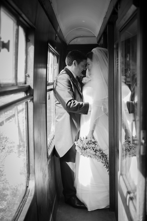 Buckinghamshire Railway Centre wedding video example - Emma and James on the steam train carriage. Photography and videography by Veiled Productions