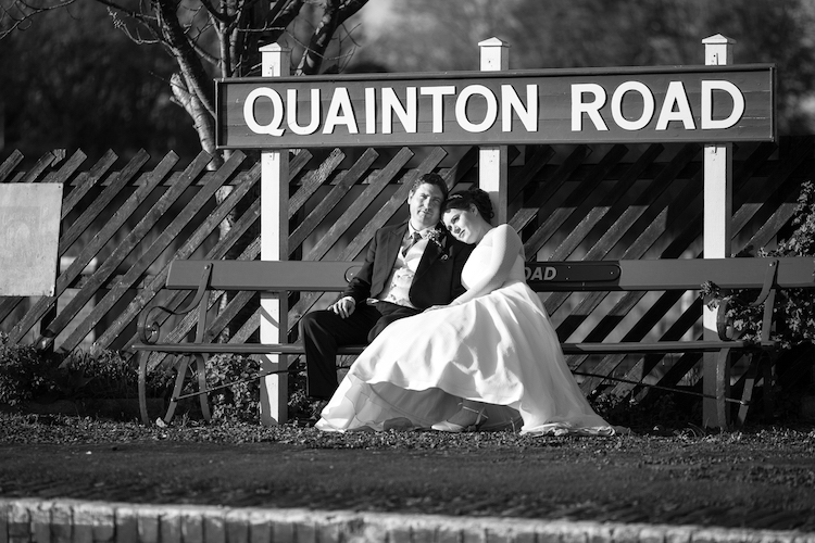 Buckinghamshire Railway Centre wedding video example - Emma and James sitting at the platform - photography and filmed by Veiled Productions