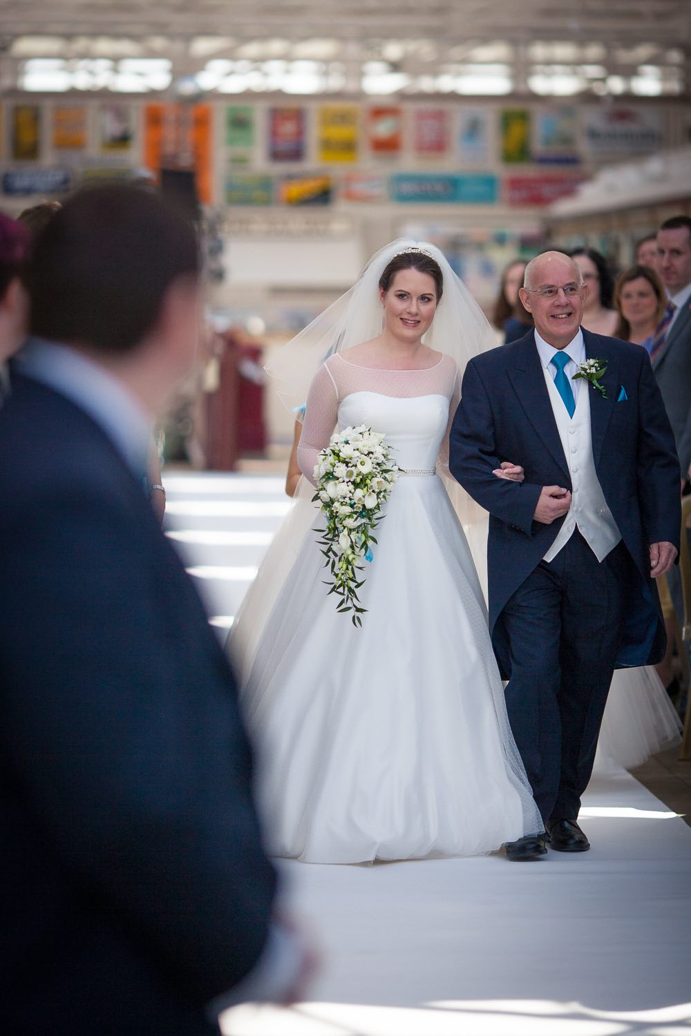 Emma walking down the aisle with her Dad - Buckinghamshire Railway Centre wedding video and photography by Veiled Productions. Fun, unique wedding films for modern, family focused couples.
