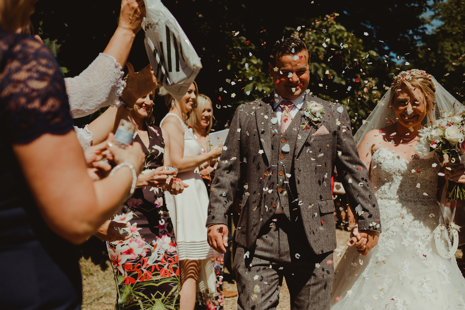 Cat and Calum wedding day at the Garden Barn wedding venue, throwing the confetti after the ceremony. Photo thanks to Lee Allison Photography.