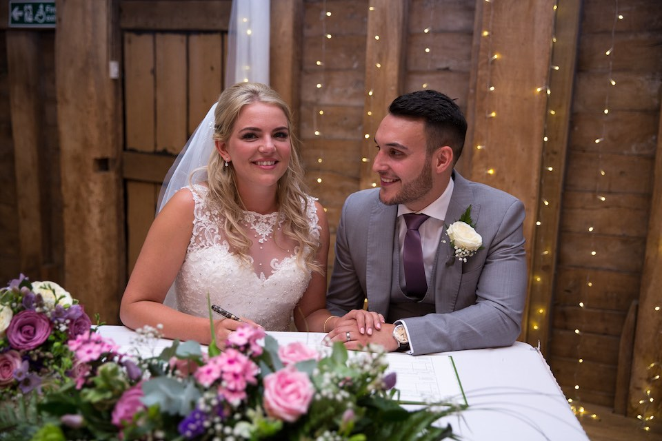 Ashleigh and Jamie's wedding ceremony at The Priory barn wedding venue hertfordshire. Photography and videography by Veiled Productions - fun, unique wedding films for modern, family focused couples