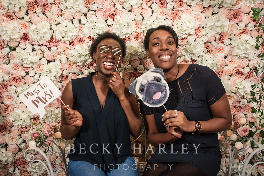 Lots of fun at the flower wall photo booth at the Engage Wedding Planning Party at Coltsfoot Country Retreat by Becky Harley Photography