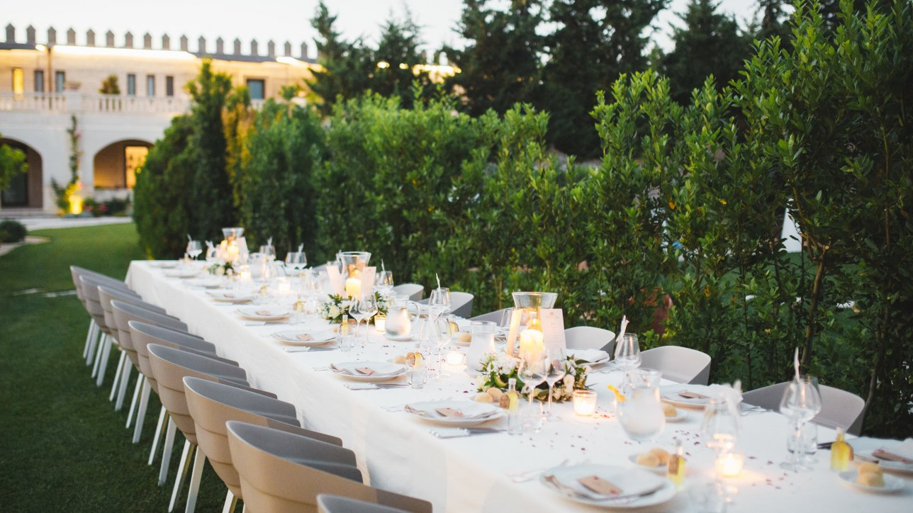 Table set up outdoors for a destination wedding - Claire Clarke Destination Wedding Advice - Photo by Cat Lane Weddings