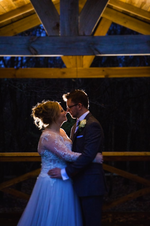 Hannah and Mike Winter Wedding at Bury Court Barn on the terrace by Em J Photography. Videography by Veiled Productions