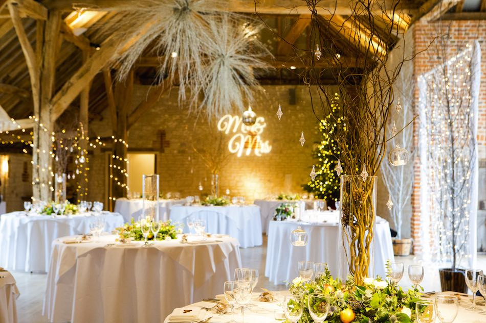 Hannah and Mike Winter Wedding at Bury Court Barn - winter decor by Em J Photography. Videography by Veiled Productions