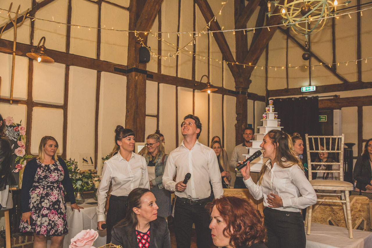 The singing waiters surprise everyone at the Engage Weddings Wedding Planning Party wedding fair Bedford. Image thanks to Nicki Shea Photography