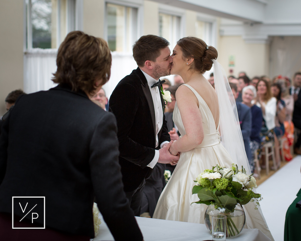 A spring Pembroke Lodge wedding - Liz and Luke seal their wedding with a kiss - photography and videography by Veiled Productions