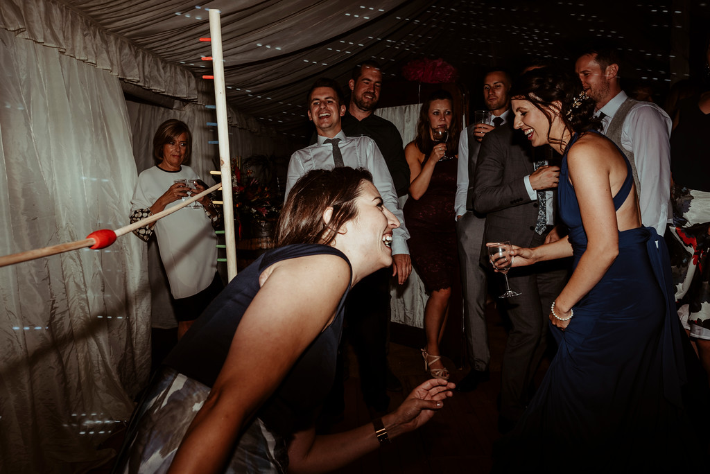 Jenny and Charlie Caribbean themed wedding - evening fun limbo - photography by Jess Soper Photogaphy, videography by Veiled Productions
