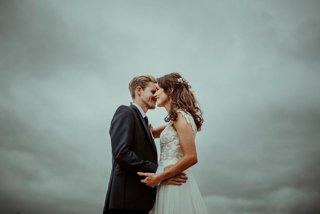 Jenny and Charlie Caribbean themed wedding - couples portrait moody sky - photography by Jess Soper Photogaphy, videography by Veiled Productions