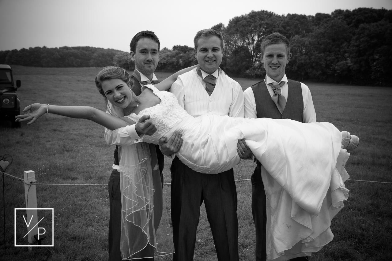 Matt and his groomsmen carrying Phillipa - wedding day traditions