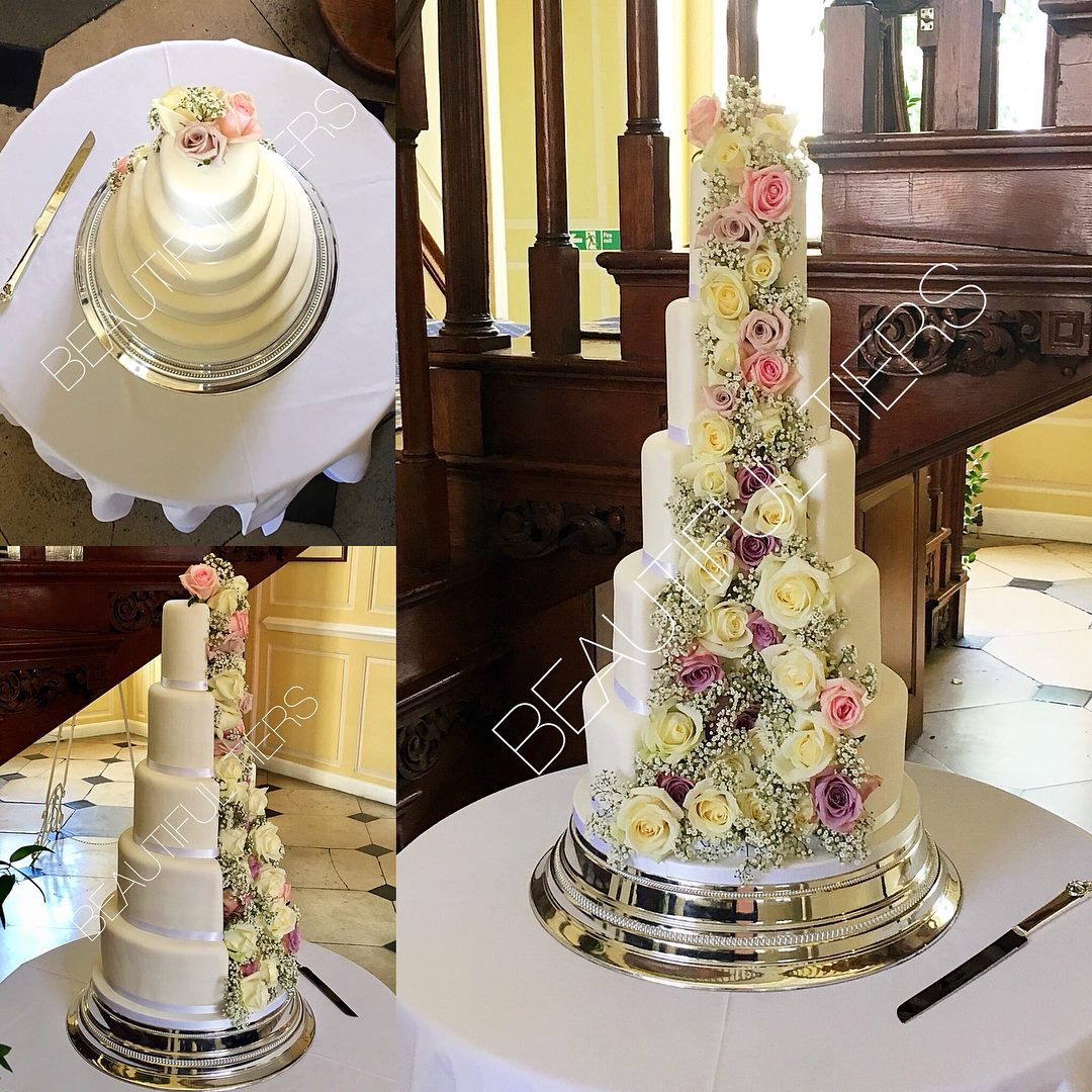 Incredible wedding cake with fresh flowers by Beautiful Tiers based in Haverhill. Gosfield Hall wedding of Peter and Tracy.