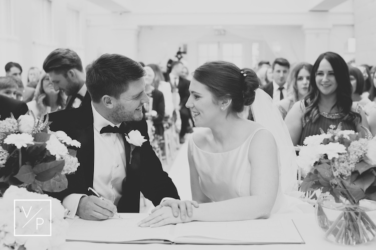 Best timings for your wedding day - Liz and Luke after signing the register - wedding photography and videography by Veiled Productions