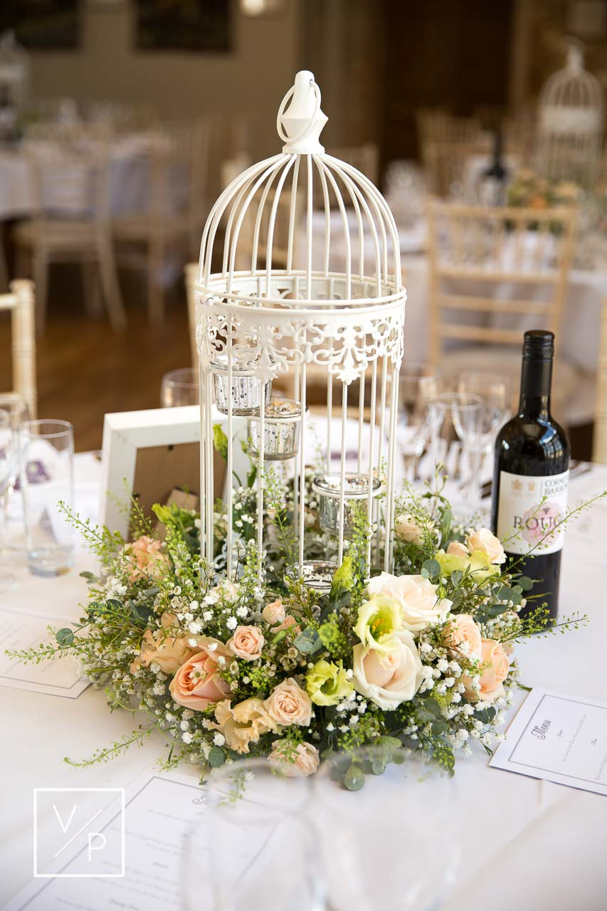 Ask your wedding photographer and videographer to capture the details before your guests sit down. Photography and videography by Veiled Productions.