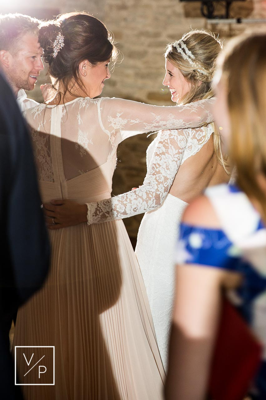 Dos and don'ts for your wedding - don't forget to have a dance! Christina having a dance with her bridesmaid and groomsmen. Photography and videography by Veiled Productions in Oxfordshire.