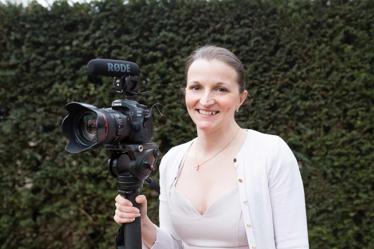 Rachel and her trusty camera. Questions to ask your wedding videographer.
