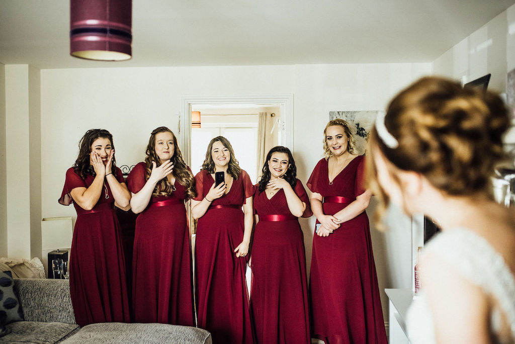 Jess' bridesmaids reaction to seeing her in her wedding dress for the first time. Photo courtesy of Michelle Wood Photographer.