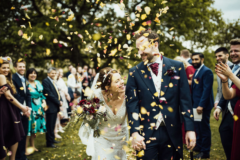 Confetti throw in the grounds of Shuttleworth House - Jess and Sam wedding. Photo thanks to Michelle Wood Photographer. Shuttleworth House wedding videographer Veiled Productions.