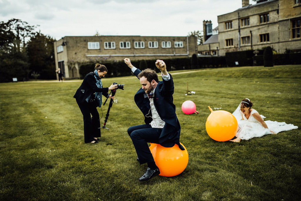 Rachel from Veiled Productions filming Jess and Sam having a race on space hoppers on their wedding day at Shuttleworth House. Fun wedding videography.