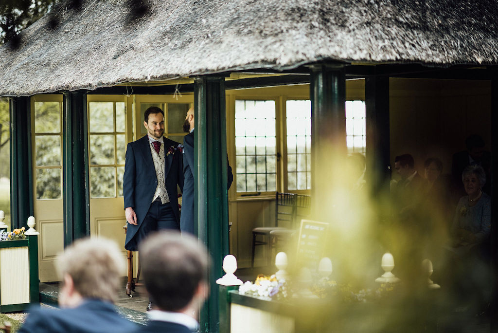 Sam waiting for Jess to arrive and for the wedding ceremony to begin in The Summer House at Shuttleworth House. Photo thanks to Michelle Wood Photographer.