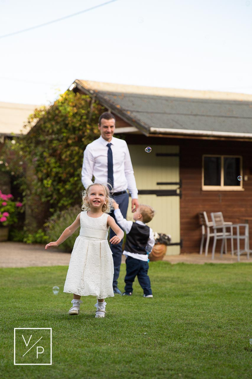 Children having fun during a wedding reception at The Great Barn Aynho - photography and videography by Veiled Productions
