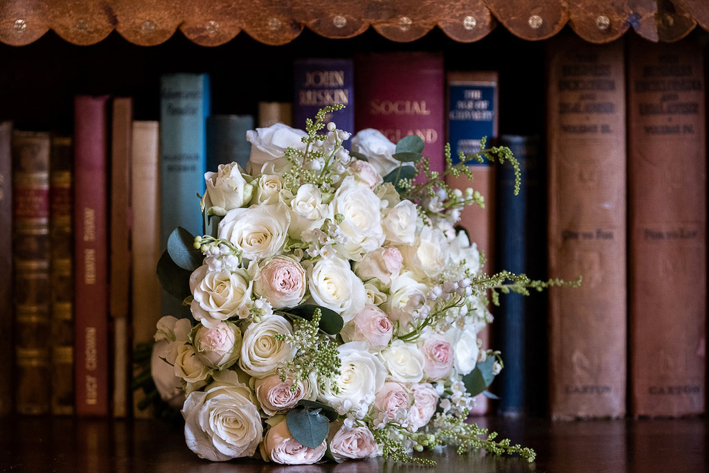 Bridal bouquet with white and light pink roses - photography by Rob Wheal Photography | Oxfordshire wedding videography by Veiled Productions
