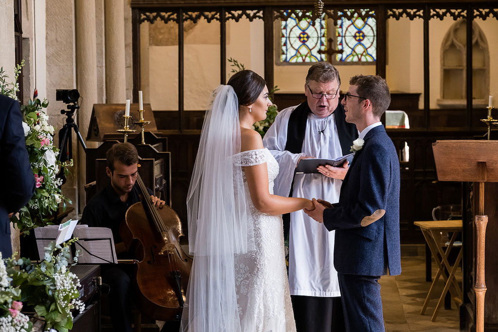 Rebecca and Mark making their wedding vows - photography by Rob Wheal Photography | Oxfordshire wedding videography by Veiled Productions