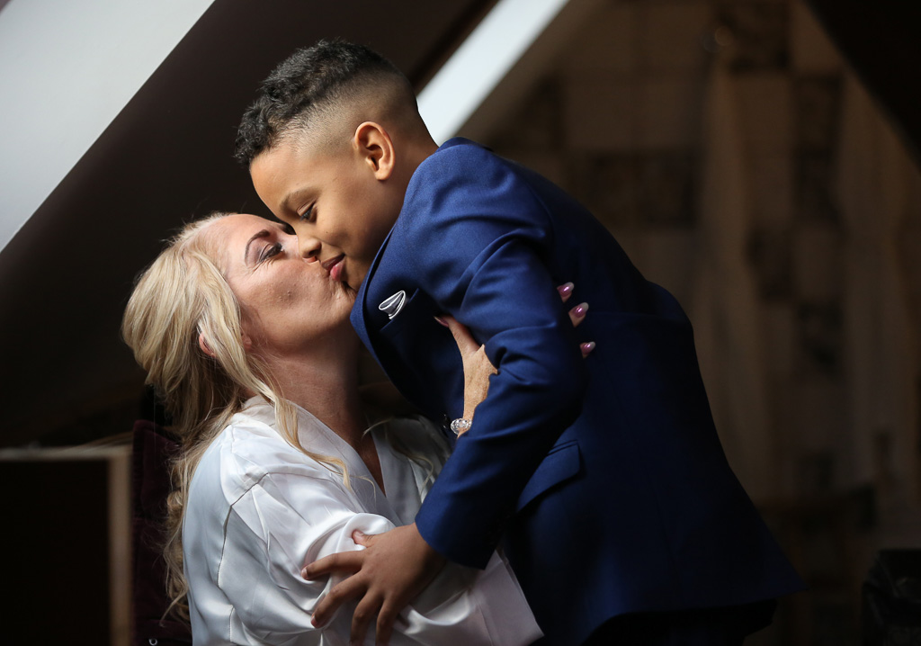 Bride getting ready for wedding sharing a hug with her son before the ceremony - unique wedding preparation photos - Photography by Wrapp Weddings - Videography by Veiled Productions - The Barns at Redcoats wedding videographer