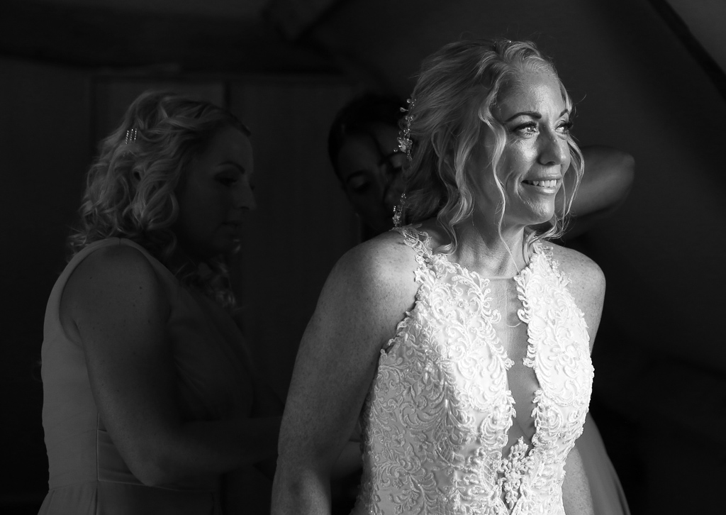 Bride Leanne with her bridesmaids getting ready in the honeymoon suite at The Barns at Redcoats Bride - Photography by Wrapp Weddings - Videography by Veiled Productions - The Barns at Redcoats wedding videographer