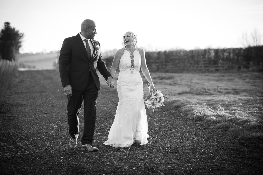 Happy couple taking a walk on their wedding day at The Farmhouse at Redcoats - Photography by Wrapp Weddings - Videography by Veiled Productions - The Barns at Redcoats wedding videographer