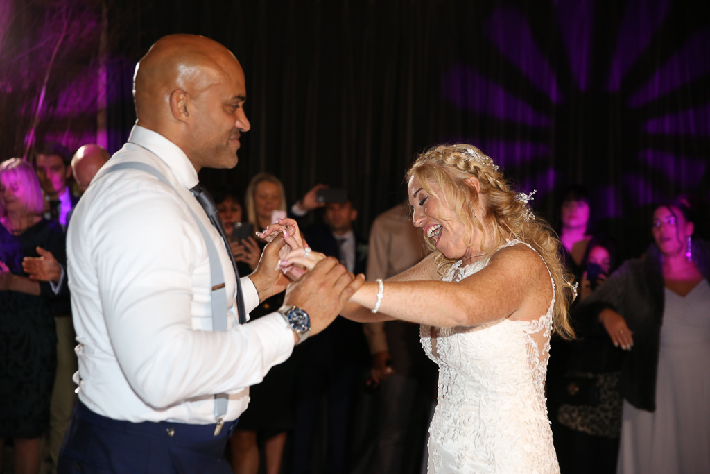 First dance on the dancefloor at The Farmhouse at Redcoats - Photography by Wrapp Weddings - Videography by Veiled Productions - The Barns at Redcoats wedding videographer
