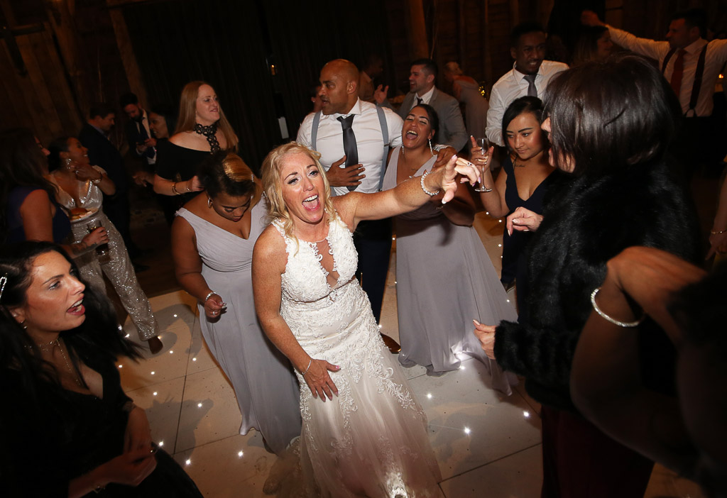 Bride Leanne partying on the dancefloor - Photography by Wrapp Weddings - Videography by Veiled Productions - The Barns at Redcoats wedding videographer